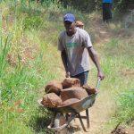 The Water Project: Mwichina Community, Matanyi Spring -  Bringing Stones