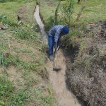 The Water Project: Kalenda B Community, Lumbasi Spring -  Digging The Drainage Channel