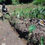 The Water Project: Emurumba Community, Makokha Spring -  Digging Drainage Channel