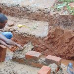 The Water Project: Imusutsu Community, Ikosangwa Spring -  Brick Setting