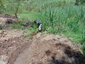 The Water Project:  Digging Drainage Channel