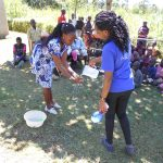 The Water Project: Kalenda A Community, Webo Simali Spring -  Trainers Demonstrate Handwashing