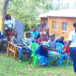 The Water Project: Mubinga Community, Mulutondo Spring -  Participants Listen To Trainer Laura
