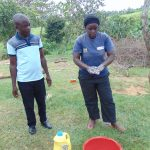 The Water Project: Emurumba Community, Makokha Spring -  Chv Grace Aswani Shows Handwashing