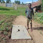 The Water Project: Mukangu Community, Metah Spring -  Owner Of New Sanitation Slab