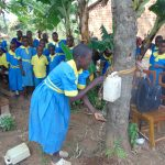 The Water Project: Saride Primary School -  Demonstration Using A Leaky Tin