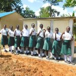 The Water Project: Sawawa Secondary School -  Girls Posing With Vip Latrines