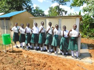 The Water Project:  Girls Posing With Vip Latrines