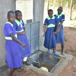 The Water Project: Khwihondwe SA Primary School -  Girls Pose With Rain Tank