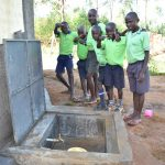 The Water Project: Khwihondwe SA Primary School -  Boys Pose With Rain Tank