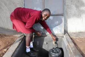 The Water Project:  Sylvia Collects Water