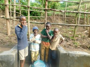 The Water Project:  Boys Pose With The Spring