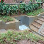 The Water Project: Imusutsu Community, Ikosangwa Spring -  Water Flows From Ikosangwa Spring