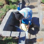 The Water Project: Mukangu Community, Metah Spring -  Washing Container Before Fetching Water