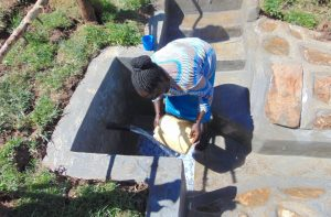 The Water Project:  Washing Container Before Fetching Water