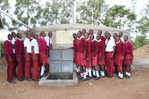 The Water Project:  Students Stand Proudly With The Tank