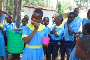 The Water Project:  Demonstrating Toothbrushing