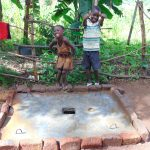 The Water Project: Maondo Community, Ambundo Spring -  Kids With Curing Sanitation Platform