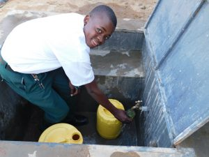 The Water Project:  Pupil John Collecting Water