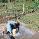 The Water Project: Emurumba Community, Makokha Spring -  Enjoying Spring Water