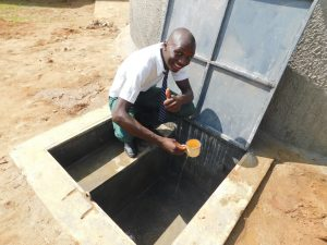 The Water Project:  Pupil Elijah Enjoying A Drink