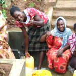 The Water Project: Namarambi Community, Iddi Spring -  Women Give Thumbs Up