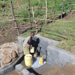 The Water Project: Emurumba Community, Makokha Spring -  Smiles While Fetching Water
