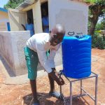 The Water Project: Bumbo Primary School -  Handwashing In Front Of Boys Latrines