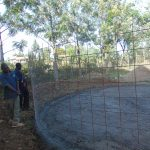The Water Project: Friends School Ikoli Secondary -  Adjusting Wire For Tank Walls