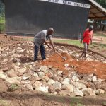 The Water Project: Chiliva Primary School -  Filling In Rain Tank Foundation