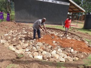 The Water Project:  Filling In Rain Tank Foundation