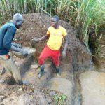 The Water Project: Namarambi Community, Iddi Spring -  Laying Stair Foundation