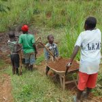 The Water Project: Musiachi Community, Mutuli Spring -  Kids Help Collect Sand