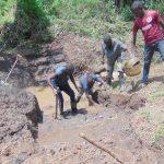 The Water Project: Mubinga Community, Mulutondo Spring -  Community Helps Excavate