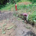 The Water Project: Maondo Community, Ambundo Spring -  Opening Up Drainage Channel