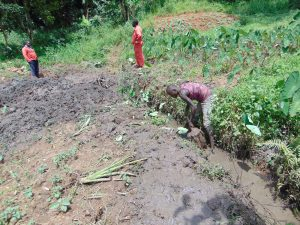 The Water Project:  Opening Up Drainage Channel