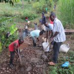 The Water Project: Rosterman Community, Lishenga Spring -  Community Mixes And Passes Concrete Down To Artisan