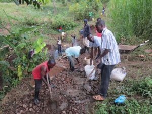 The Water Project:  Community Mixes And Passes Concrete Down To Artisan