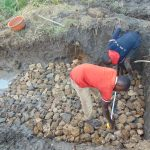 The Water Project: Emurumba Community, Makokha Spring -  Laying The Foundation