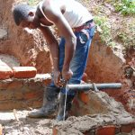 The Water Project: Imusutsu Community, Ikosangwa Spring -  Pipe Measurement And Setting
