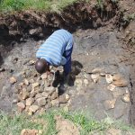 The Water Project: Mukangu Community, Metah Spring -  Laying Foundation