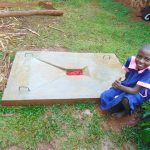 The Water Project: Kitulu Community, Kiduve Spring -  Pupil Poses With Her Familys New Sanplatjpg