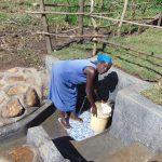 The Water Project: Emurumba Community, Makokha Spring -  Fetching Spring Water