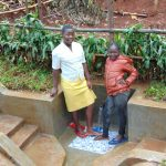 The Water Project: Imusutsu Community, Ikosangwa Spring -  Posing With The Spring