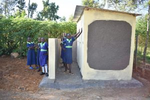 The Water Project:  Girls Stand With New Vip Latrines