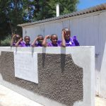 The Water Project: Chiliva Primary School -  Girls Pose With New Latrines