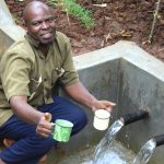 The Water Project: Namarambi Community, Iddi Spring -  Here Have A Drink
