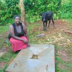 The Water Project: Kitulu Community, Kiduve Spring -  New Sanitation Slab Owner