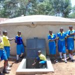 The Water Project: Saride Primary School -  Pupils Pose With Rain Tank