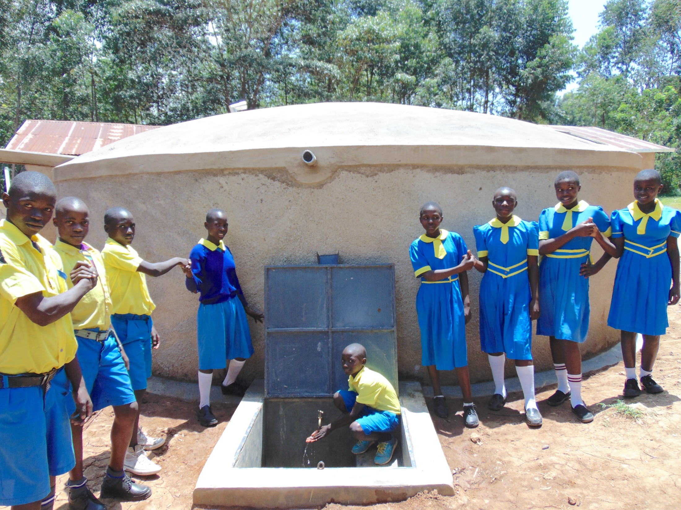 The Water Project : 42-kenya20103-pupils-pose-with-rain-tank